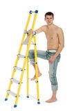Young man with a stand ladder. Royalty Free Stock Image