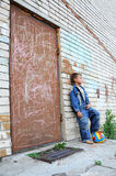 Young man standing against graffiti Royalty Free Stock Photography