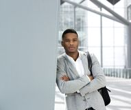 Young man standing in airport with bag Stock Images