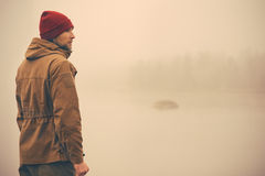 Young Man standing alone outdoor stock image