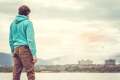 Young Man standing alone outdoor Travel Lifestyle stock photos