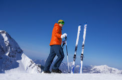 Young man standing alone with ski in snow Royalty Free Stock Photos