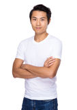 Young man standing with arms crossed Stock Photography