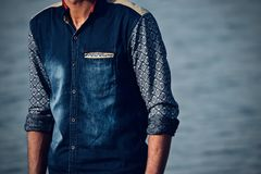 Man standing wearing the stylish jeans shirts stock photograph stock images