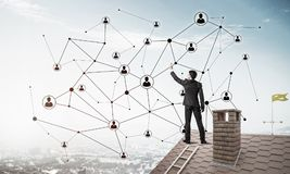 Businessman on house roof presenting networking and connection c Royalty Free Stock Photo