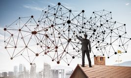 Businessman on house roof presenting networking and connection c Royalty Free Stock Image