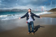 Young man standing on the beach royalty free stock photos