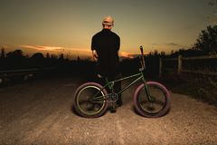 Free Young Man Standing Bmx Bike. BMX Rider With And A Sunset Stock Photos - 129818853