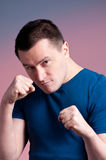 Young man standing in a boxing Stock Image