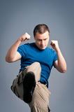 Young man standing in a boxing Stock Images