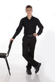Young man standing at the chair Royalty Free Stock Photo