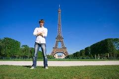 Young man standing on the Champs de Mars Stock Photography