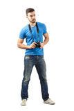Young man standing with digital camera around neck Stock Images