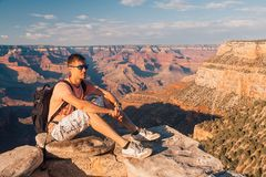 Young man standing at the edge of the Grand Canyon. On the island of Kauai, Hawaii Royalty Free Stock Photography