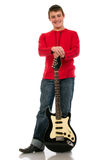 A young man standing with an electric guitar on a white background royalty free stock images