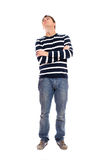Young man standing firmly Stock Image