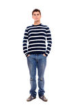 Young man standing firmly with hands in pockets Royalty Free Stock Image