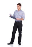 Young man standing with folder, isolated on white. Portrait of young man standing with folder, isolated on white background royalty free stock photography