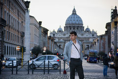 Young man standing in front of St. Peter's Square in Vatican City Royalty Free Stock Photography