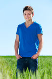 Young man standing in green field Stock Photography