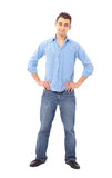 Young man standing with hands Stock Photo