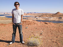 Young Man in Standing with Hands in Pockets Royalty Free Stock Photography