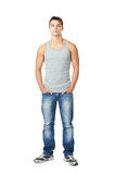 Young man standing with hands in pockets. Full length portrait of young man standing with hands in pockets isolated on white background Stock Image