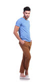 Young man standing with his legs crossed Royalty Free Stock Photos