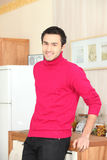 Young man standing in kitchen Royalty Free Stock Photos