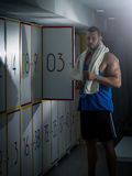 Young man standing in locker room Stock Photography