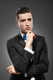 Young man is standing lost in thought Royalty Free Stock Photos