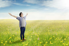 Young man standing on the meadow Stock Photos