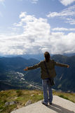 Young man standing on mountain Stock Photos