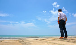 Young man standing near the beach Stock Images
