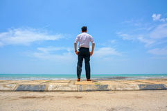 Young man standing near the beach Royalty Free Stock Photo