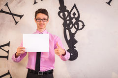 Young man standing near the big clock Royalty Free Stock Photography