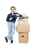 Young man standing near the pile of boxes stock photography