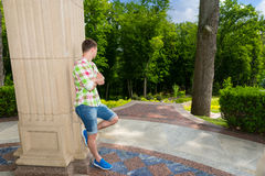 Young man standing near wall Royalty Free Stock Image