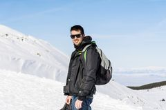 Young Hiker Man in the  Winter Mountain. Young man  standing near  winter mountain valley - adventure concept Royalty Free Stock Photography