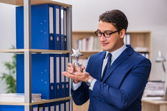 The young man standing next to the shelf with folders Royalty Free Stock Image