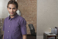 Young Man Standing In Office Stock Photography