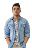 Young man standing with open denim shirt. Handsome young man standing with open denim shirt, looking at camera, isolated Royalty Free Stock Image