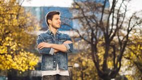 Young man standing outdoors Stock Photo