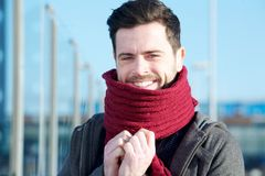 Young man standing outdoors with scarf covering face Stock Images