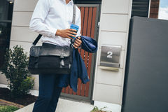 Young man standing outside his modern apartment Stock Photos