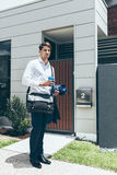 Young man standing outside his modern apartment Royalty Free Stock Photo