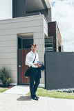 Young man standing outside his modern house Royalty Free Stock Photos