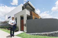 Young man standing outside his modern house Stock Photo