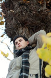 Young man standing in park. Royalty Free Stock Photos