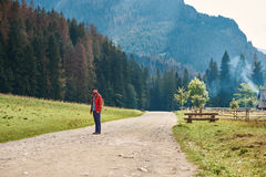 Young man standing on a path in the great outdoors Royalty Free Stock Photography